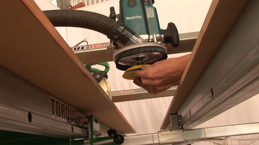 Attaching a sanding disc to a router